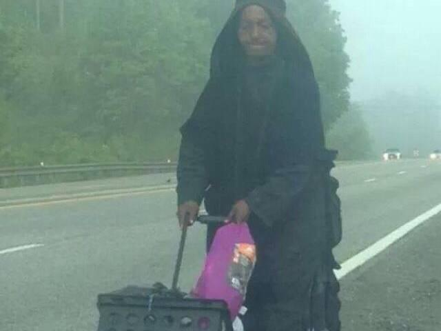 Who is the mysterious woman in black walking