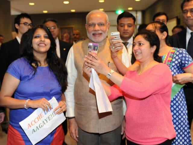 Girls crowd for selfies with PM Modi, Musical Modi: After flute, PM takes on drumming in Japan