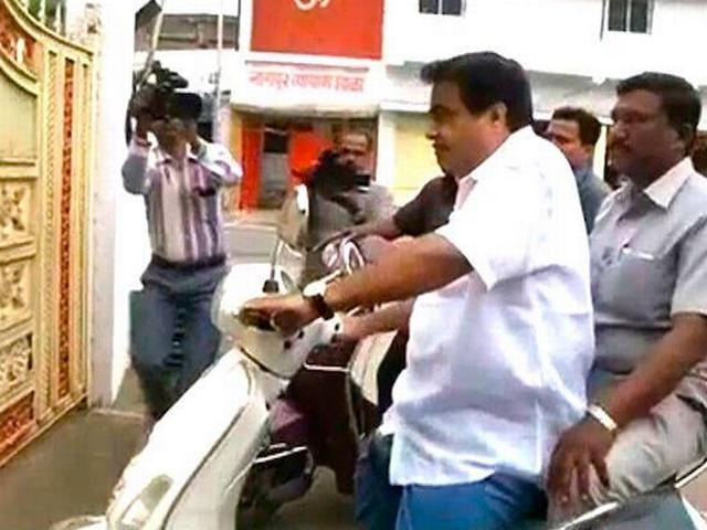 Transport minister Nitin Gadkari rides scooter without helmet