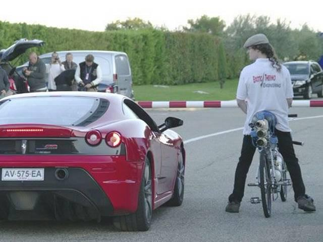 Bicycle and Ferrari compete in an unbelievable race