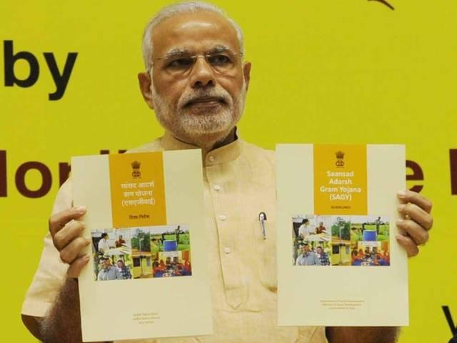 adarsh gram yojana: congress alleges gujrat parliamentarians for adopting already developed villages