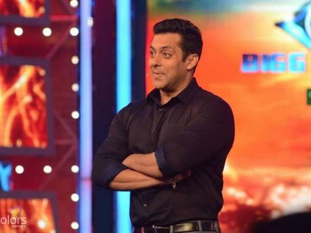 'The real smooch pictures of Shah Rukh and myself are with me,' says a witty Salman in Bigg Boss 8