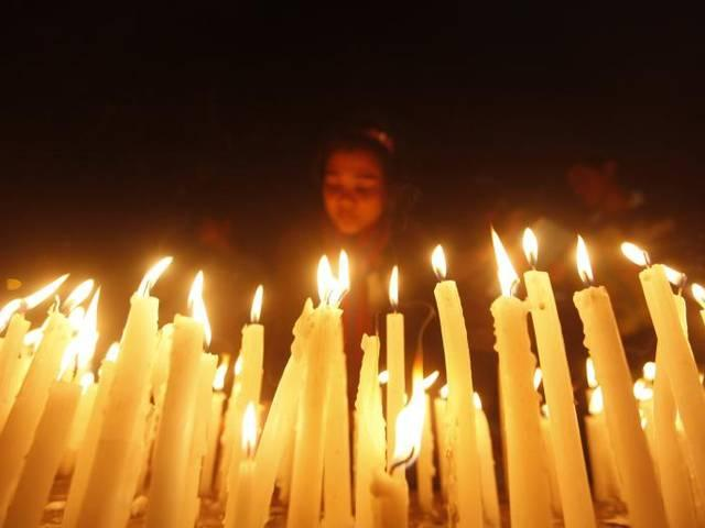 Delhi Christians hold candle-lit vigil to protest against church fire