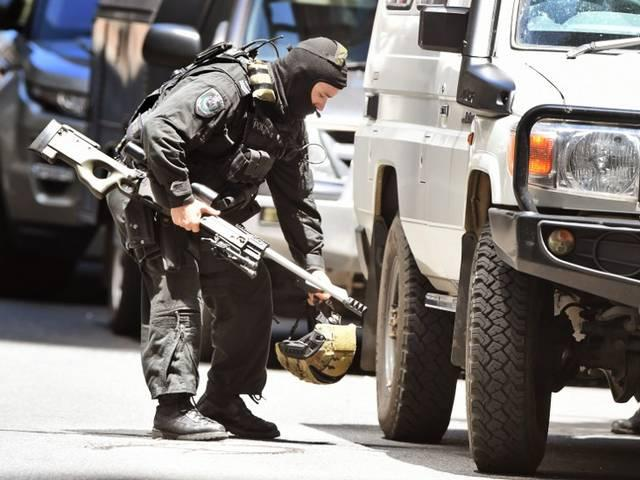 Sydney Siege: Unknown gunman holds up people inside Australia café