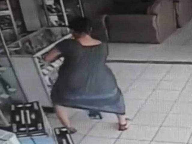 Woman steals TV by hiding it under her skirt