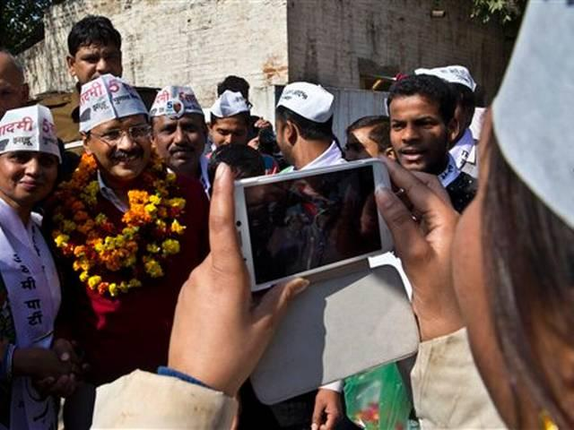 Kejriwal mobbed by media; poses for selfie with polling staff