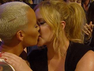 Amber Rose, Amy Schumer share intense kiss