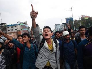 Nepalese people block traffic and shout slogans against the government