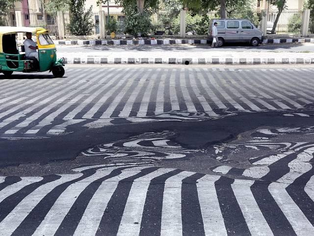 PHOTOS: It's so hot in India the roads are melting