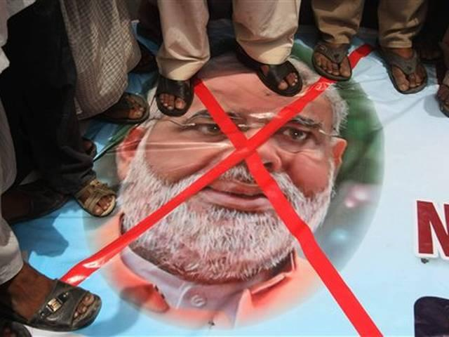 indian national flag and pm modi's posters burnt in pakistan