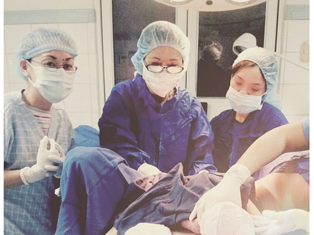 Doctors are taking selfies next to womens vaginas while
