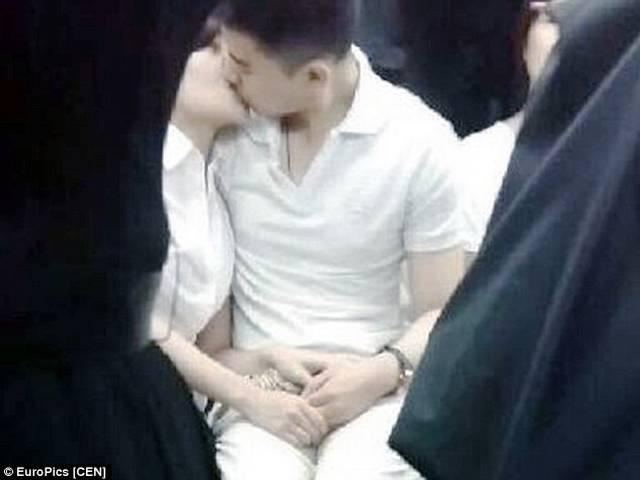 Amorous couple spark controversy for public passion on the underground