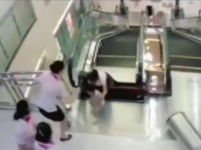 China woman dies after falling into escalator