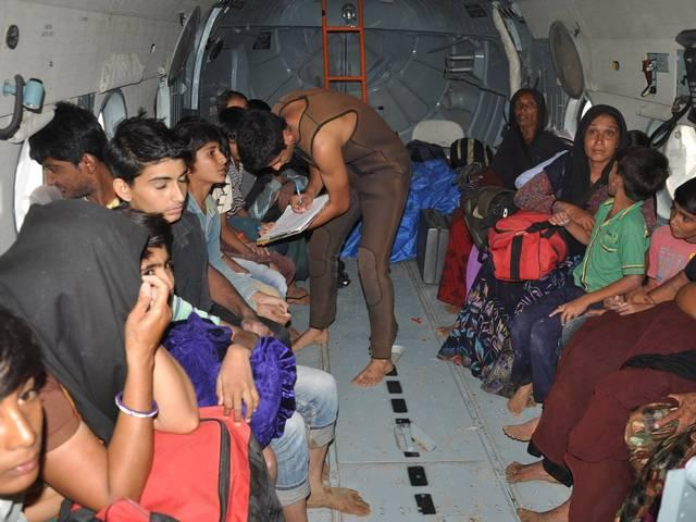 Rescue at Gugal village in Gujarat. 64 villagers, engulfed by rising flood waters, were heli-lifted by IAF Mi-17 V5 Helicopters and brought to safety