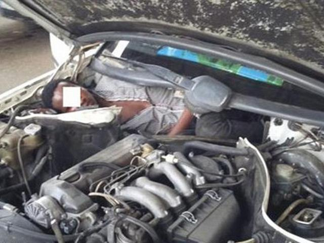 Migrant found hidden next to car's ENGINE by Spanish border officials