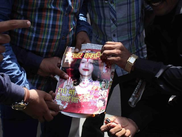 Republican Party workers protest against Radhe Maa