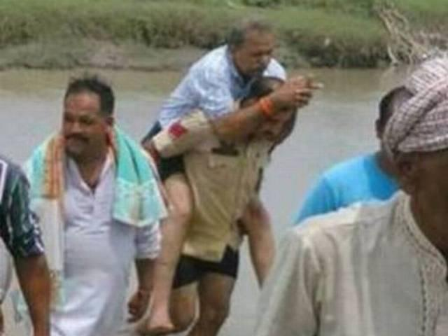 Photo of cop carrying BJP MLA in Jammu and Kashmir goes viral