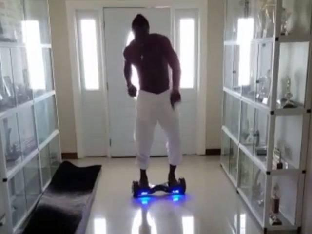 Andre Russell goes for a ride on his 'new toy'