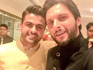Ahmed Shehzad marriage photos with his wife