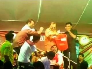 gujrat bjp leader satish patel pours hard cash from tub during ganpati fest
