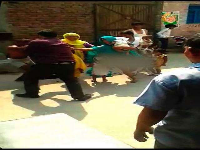 women strip before police and public in noida