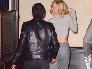 Jennifer Lawrence carries Aziz Ansari on back to enter a late night party