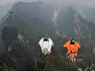 Participants carry out a trail flying in Zhangjiajie before the Wingsuit Flying World Championship