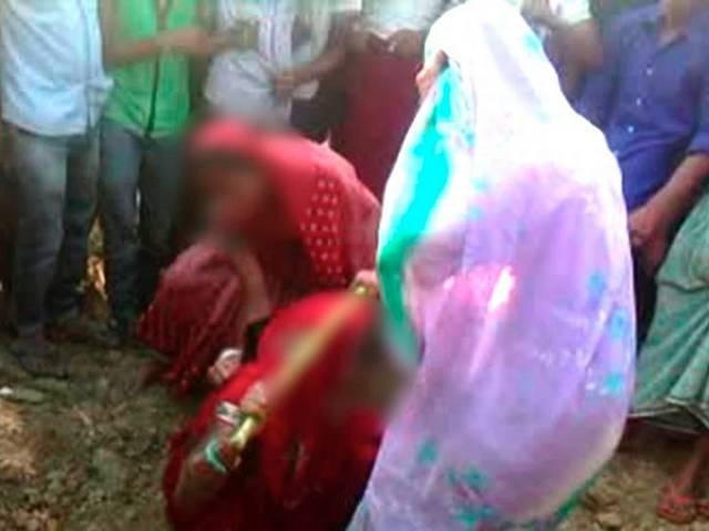woman disrobed and beaten by women