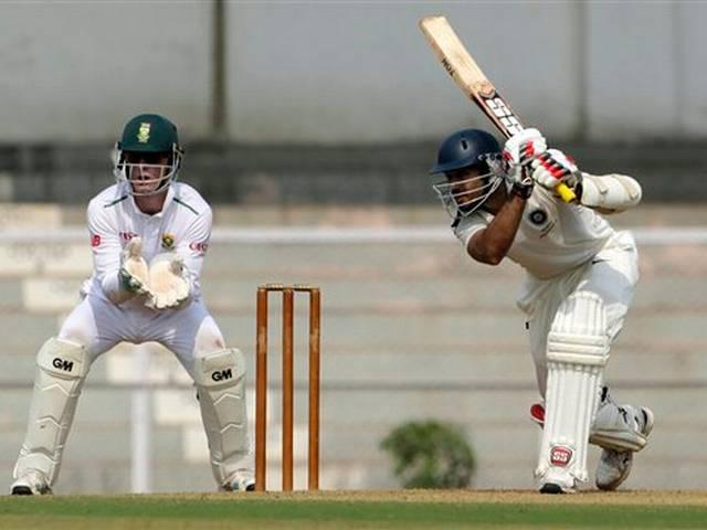 Rahul, Ojha make half tons in Board XI's modest 296