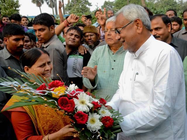 Nitish Kumar, hugged by Lalu Prasad Yadav after victory in Bihar elections in Patna