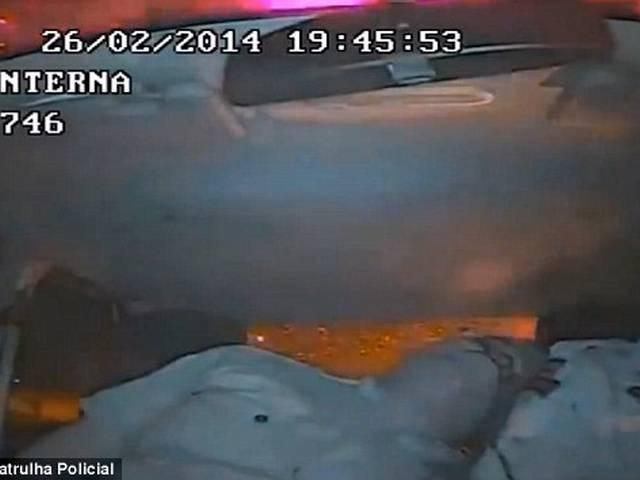 Terrifying moment Brazilian police officer is shot in the face