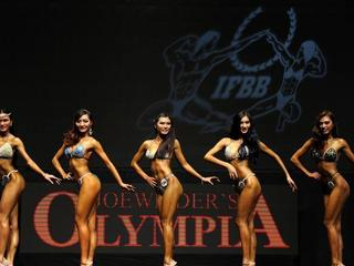 Bodybuilders show beauty of strength in a show