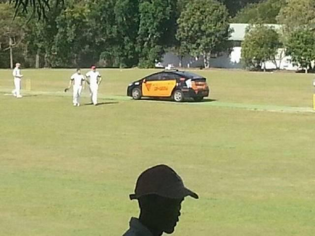Taxi Driver Park car on Cricket Pitch
