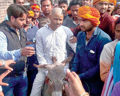 Bajrang Dal members assault Christian man, tonsure half his head, made to sit him on donkey and pass two police outposts unscathed