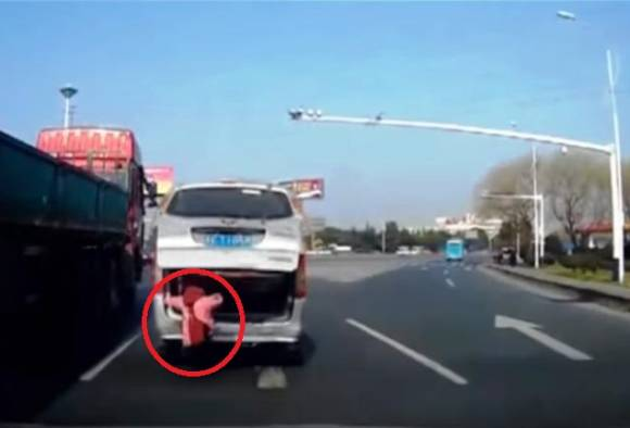 Caught on camera: In China, toddler falls from moving minivan on busy highway
