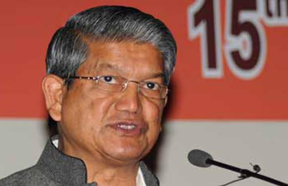 Play 'colourful' Holi, don't murder democracy: Uttarakhand CM Rawat tells BJP