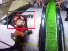 Watch: Careless mother drops her baby off the escalator