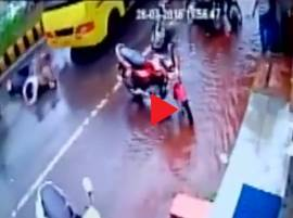 WATCH: Miraculous escape for two on a scooty after being dragged under a bus in MP