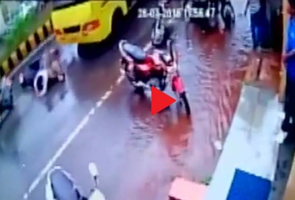 WATCH: Miraculous escape for two on a scooty after being dragged under a bus in MP's Gwalior