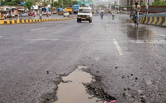 Delhi motorcyclist run over by tanker after falling into pothole