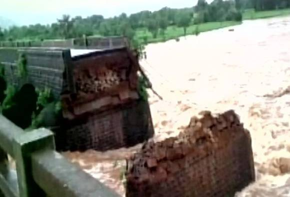India bridge collapse: 14 bodies found after buses, cars plunge into river