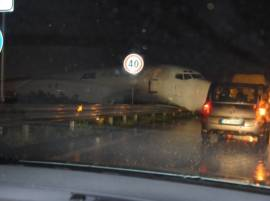 Cargo plane overshoots runway, crashes onto busy road