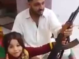 VIDEO: Pakistani father teaches little girl to fire AK-47 and threaten Narendra Modi