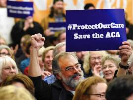 Donald Trump era begins with Obamacare rollback, protests