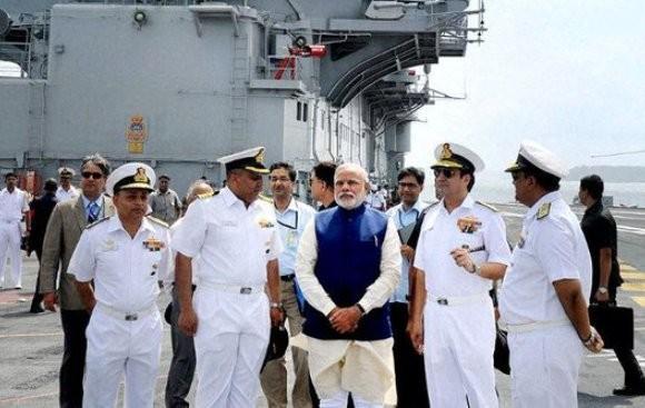 PM Narendra Modi addresses combined commanders' conference on board INS Vikramaditya