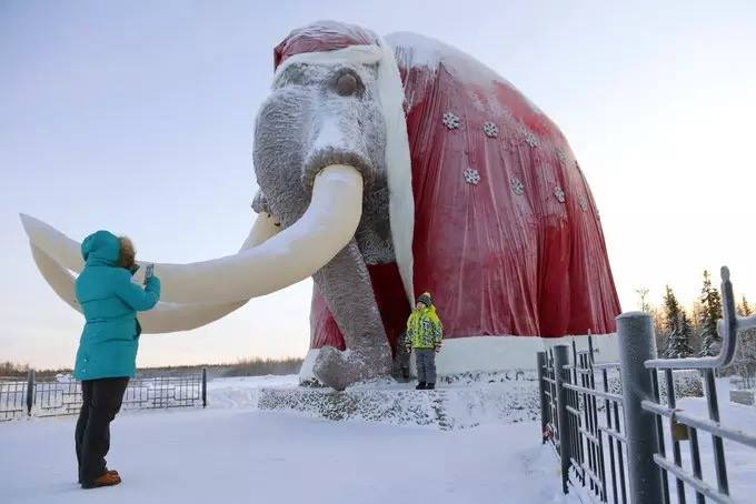 ‎mammoth‬ statue dressed up as ‪#‎FatherFrost‬ in Salekhard, North Russia