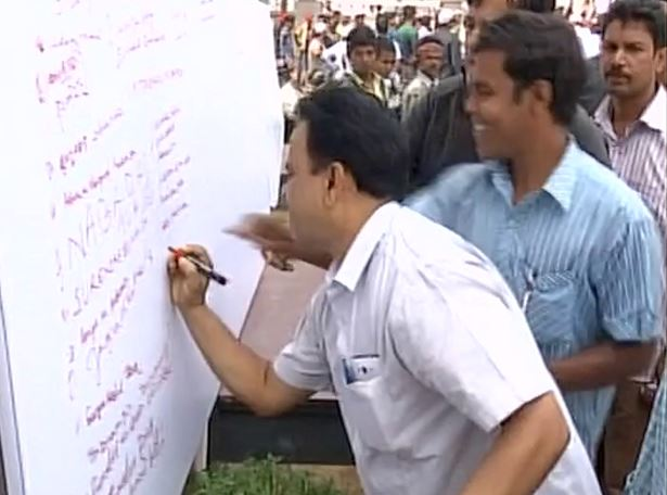 Congress supporters sign with ink and make a thumb print with blood in support of Rahul Gandhi in Bhubaneswar
