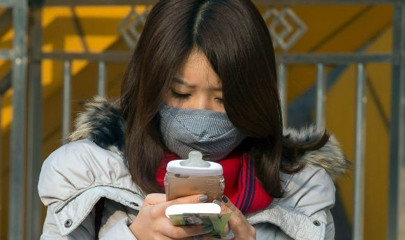 Beijing chokes under smog after second red alert
