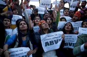 Members of Indian students organization ABVP shout slogans as they protest the release of a juvenile convicted in the fatal 2012 gang rape that shook the country in New Delhi, India, Sunday, Dec.20, 2015. The man, who was short of his 18th birthday at the time of the crime, was to finish his three-year term in a reform home on Sunday.Several activists and politicians have demanded that he not be released until it can be proven that he has been reformed. (AP Photo /Tsering Topgyal)