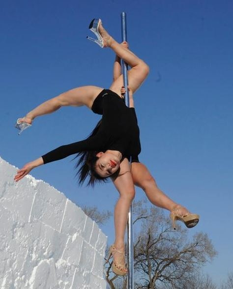 Two pole dancers performed at sub-zero temperatures on Saturday in Changchun